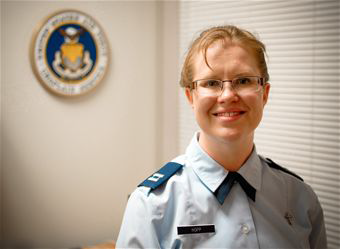 """U.S. Air Force Chaplain (Capt.) Kristi L. Hopp serves as a chaplain at the 182nd Airlift Wing in Peoria, Ill., pictured May 5, 2014. Hopp received ordination as a United Methodist Church minister June 6, 2014, after completing an 8-year process of education and evaluation. She first became interested in the military during a Veterans Affairs hospital internship. """"The stressors that we all are under in the Guard and being deployed are different. And yeah, sometimes we come back wounded, but then that's kind of what war does,"""" she said. """"It might not always wound us on the outside, but it can wound us on the inside. And so, it's a very rewarding ministry to be able to serve here."""" (U.S. Air National Guard photo illustration by Staff Sgt. Lealan Buehrer/Released)"""